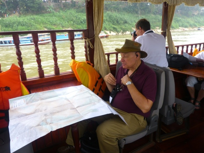 Mike, intently studying the map of the Mekong