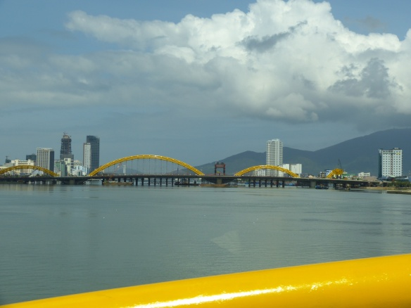 Modern DaNang, with its new bright yellow serpent bridges.