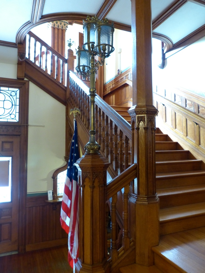 Town Hall Interior--grand staircase, with arches and carved wooden railings