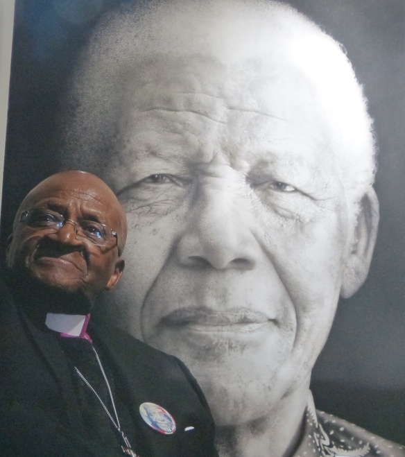 Tutu in front of a photo of Mandela, at St. George's Cathedral.  Cape Town.
