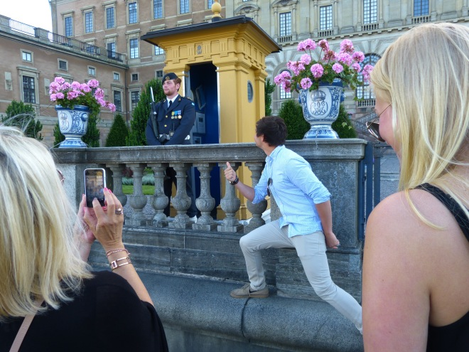 Tourists trying to distract the guard at the palace