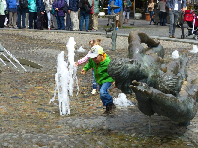 Kids enjoying the fountain in the town square